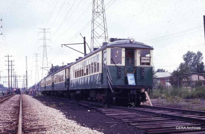 """A fantrip train of 4000s, near Skokie Shops in August 1972. The sign hanging on front says, """"This train stops at 35 for White Sox baseball today."""" (Rex K. Nelson photo - CERA Archives)"""