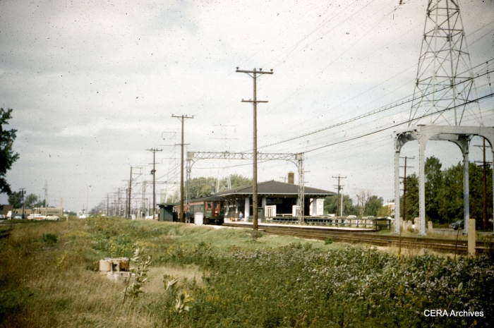 A view of the Dempster station as it looked in October 1961, with just over a year of North Shore Line service remaining. To the south of the Insull-era building, you can see the remnants of the high-level platform that would have been used for CRT Niles Center service. These were removed by CTA and a new, very basic platform was built for Swift service. (CERA Archives)