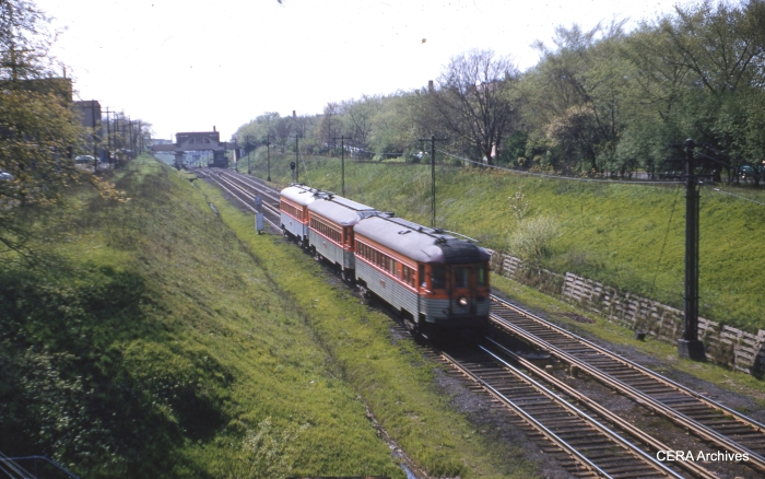 """A three-car train of North Shore """"Silverliners"""" in the Evanston open cut in May 1955. (CERA Archives)"""