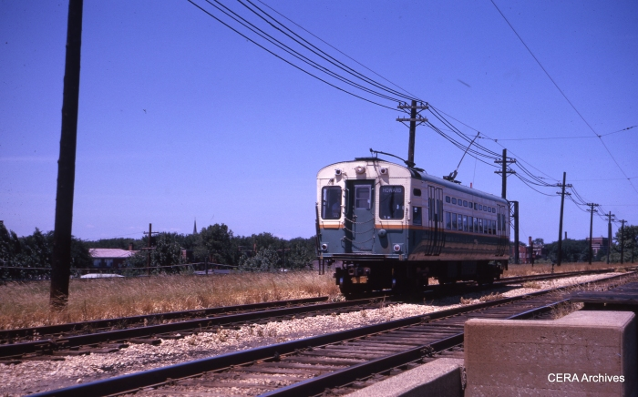 From 1961 to 1973, CTA operated PCC single car units in Evanston service with trolley poles. Some of these cars were eventually adapted for use in Skokie service. Here we are opposite Calvery cemetery. (CERA Archives)