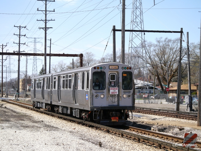 A regular service train heads east at East Prairie Road.