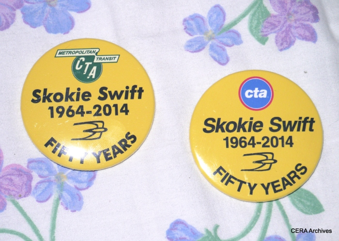 Officials handed out two commemorative pinback buttons on the special train, with the old and new CTA logos.