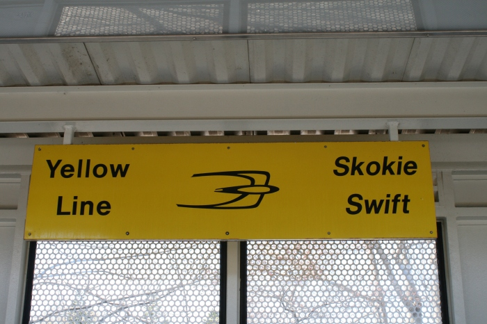 Modern Swift sign at the newer Dempster/Skokie station, which replaced the crummy Swift fiberglass lean-to that had served for decades. Pretty nice, actually, though the Ventra card machines were typically balky. (Bill Becwar Photo)
