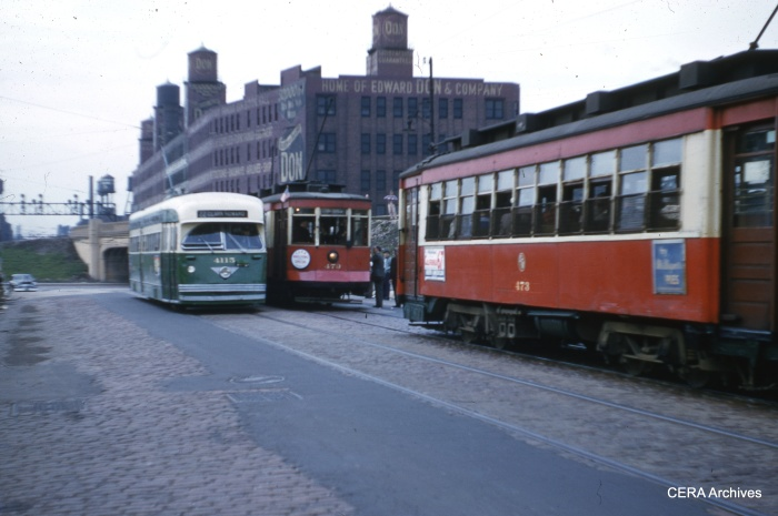 PCC 4113 passes the fantrip cars at Clark and Cermak. (Richard C. Cerne Photo - CERA Archives)