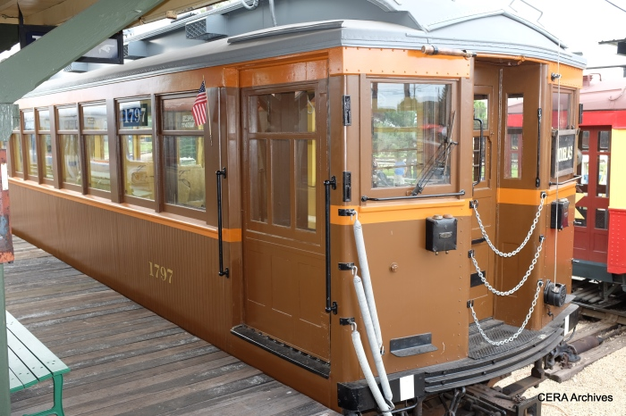 """Wooden """"L"""" car 1797, awaiting the arrival of C&WT 141 at 50th Avenue."""