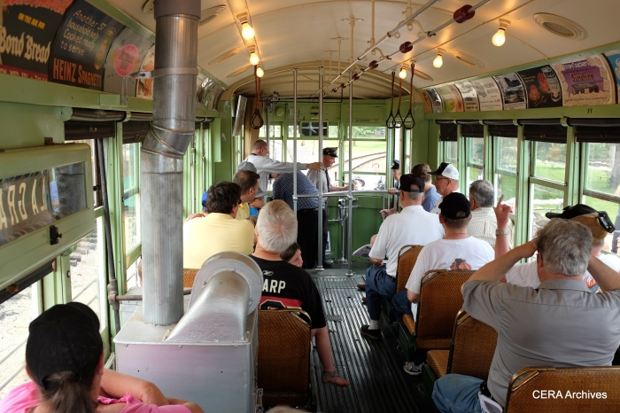 Enthusiastic fans aboard 141. Note the stove, used to heat the car in winter.