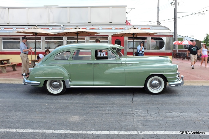 A side view of the 1948 Chrysler parked in front of the IRM Diner.