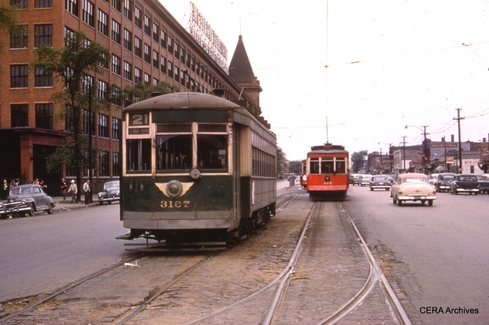 CTA 3167, the regular service car, prepares to go out ahead of 473 and 479, the fantrip cars, in this May 16, 1954 scene at the west end of the route 21 Cermak line. The famous Western Electric plant is at left. These cars looked much better in CSL red than they did in CTA green.