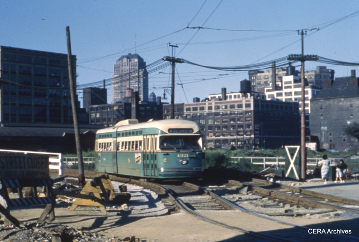Post-war PCC 4321 negotiates shoo-fly trackage on Halsted, related to construction of the Congress Expressway, in this 1952 scene.