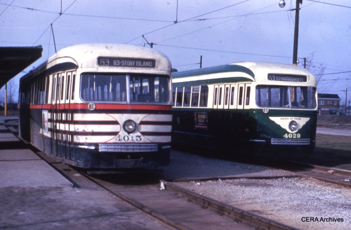 "CTA streetcars 4015 and 4029 are part of the same 1936 CSL order for 83 cars, yet look much different. 4015 is still in its CSL ""tiger stripes,"" meant to alert motorists that these cars were wider than previous ones, while 4029 is in the newer CTA green and creme. This picture was probably taken early in 1952. The scene is 63rd and Narragansett, the west end of the line."