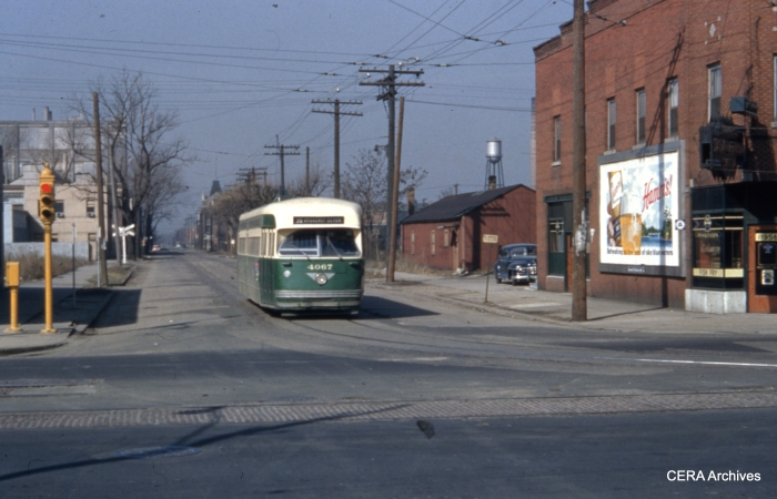 At the south end of the long 36-Broadway-State line, Pullman-built PCC 4067 prepares to make the turn at 120th and Halsted on March 21, 1954. Tracks of the former Chicago and Interurban Traction Company are in the foreground.
