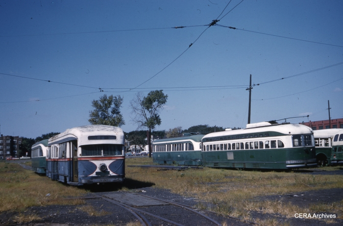 It's September 10, 1959, and there has been no Chicago streetcar service for more than a year, yet a few forlorn cars remain on the property at South Shops. Visible are cars 7001 (the experimental 1934 Brill pre-PCC), a post-war car, 4021, and at least one additional prewar car. (Clark Frazier Photo - CERA Archives)