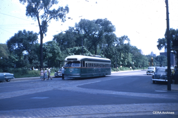 Car 7180, northbound at Clark and Wells on route 22, discharges passengers near Lincoln Park in the mid-1950s.
