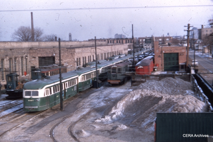 CTA 4027 and a lineup of pre-war PCCs at Devon Station (car barn) in January 1956. These cars were used on route 49-Western from June 18, 1955 to June 17, 1956.