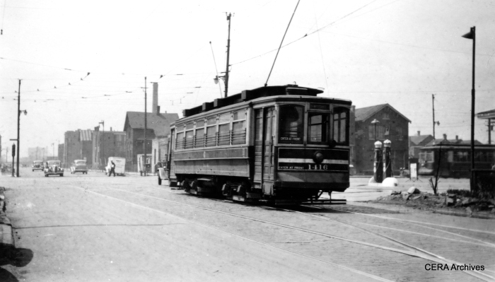 One-man city car 1416. Note the classic gas pumps at right. (R. J. Anderson Photo - CERA Archives)