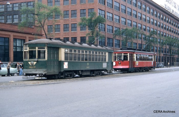 479, at Cermak and Kenton, lets the regular service car go out ahead of it. The Western Electric plant is in the background. (CERA Archives)