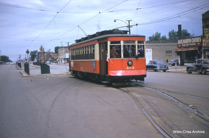 The 473 at Cermak and Kenton, the end of Route 21. Just a few years earlier, passengers would transfer from Chicago Surface Lines streetcars to those of the Chicago & West Towns Railways. Since the abandonment of West Towns trolley service in 1948, the area behind the red Pullman has been paved as a bus loading/unloading area. (Bill Hoffman Photo - Wien-Criss Archive)