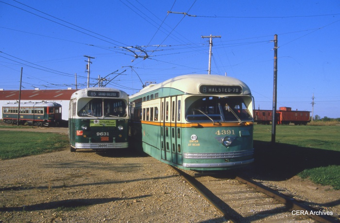 "CTA ""Green Hornet"" PCC 4391 at the Illinois Railway Museum in the mid-1980s. Also visible are CTA trolley coach 9631 and North Shore Line interurban car 160. (David Sadowski Photo - CERA Archives)"