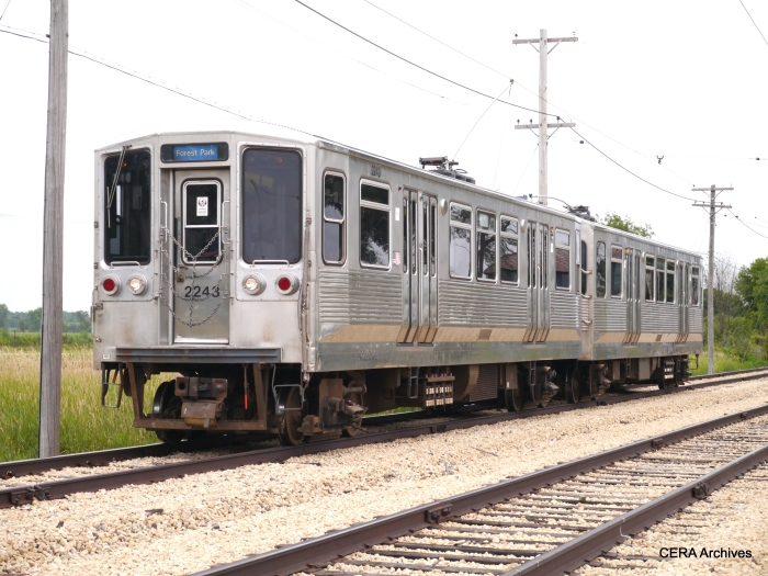 CTA 2243-2244, now fitted with trolley poles, approaching Olson Road. (David Sadowski Photo)