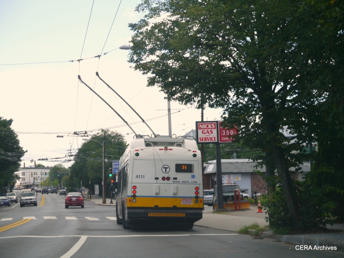 The back end of an MBTA Route 71 trackless along Mt. Auburn.