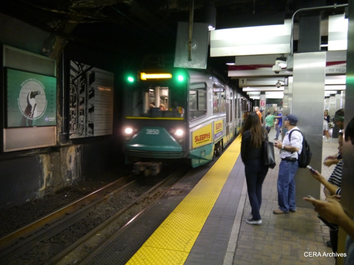 A train prepares to stop in the Green Line subway.