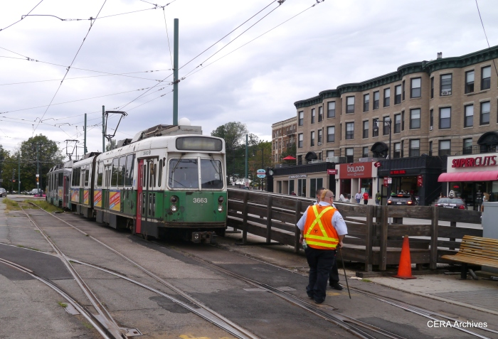 Workers switching a two-car train for the return trip from Cleveland Circle.