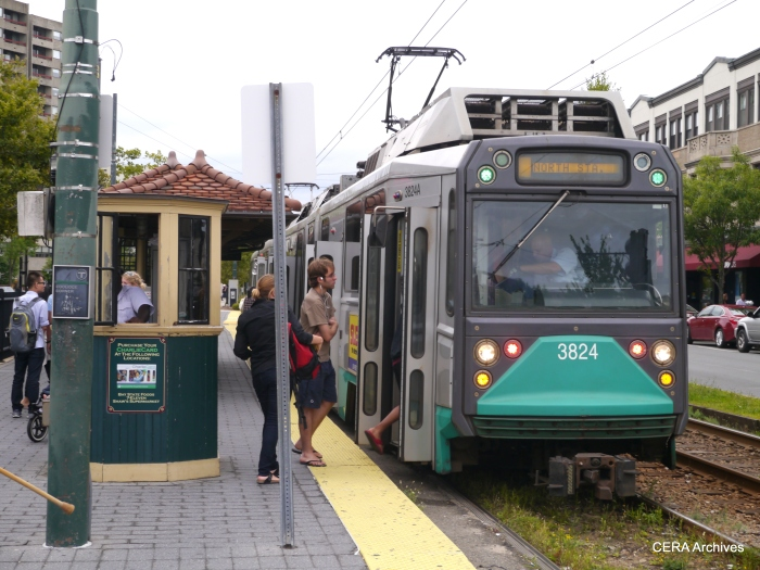 Passengers board a low-floor Breda at Coolidge Corner.