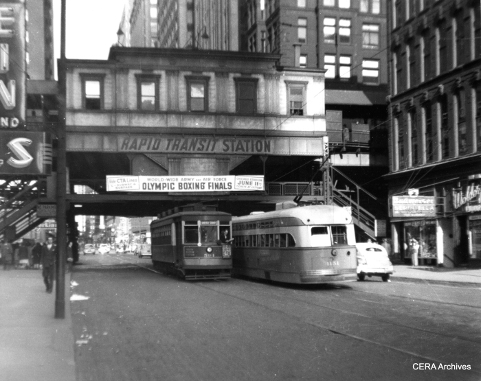 CTA red Pullman 594 passes Pullman PCC 4131 at Madison and Wells in 1947. There is about 40 years' difference in ages between the cars. The PCC is a Madison car, and 594 is on a variant of the Milwaukee route. We are looking east. (CERA Archives)
