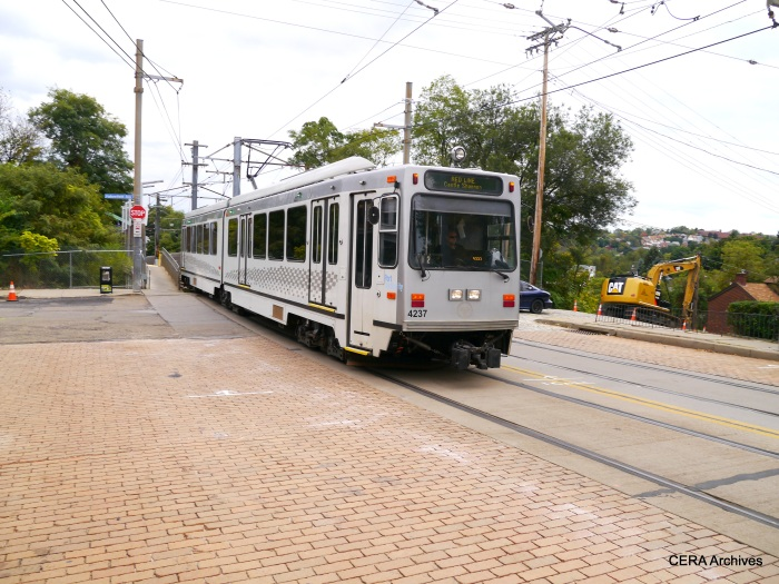 Outbound PAT 4237 leaves the Fallowfield station and enters a mile or so of street trackage along Broadway in the Beechview neighborhood (October 5, 2014).
