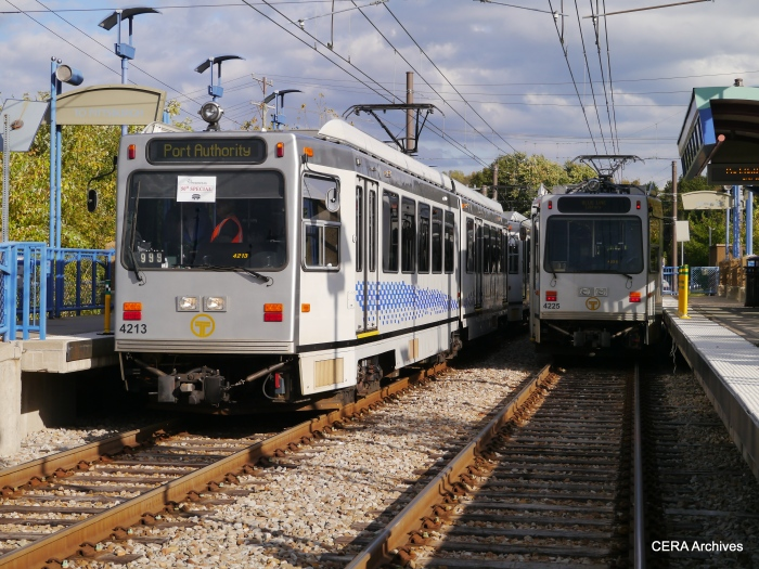 The PAT fantrip train, led by 4213, prepares to depart Library station while regular service car 4225 will go into the pocket track (October 5, 2014).