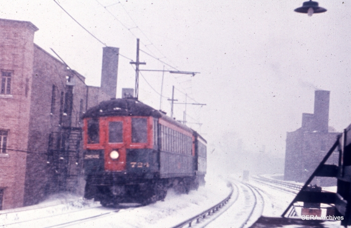 On a snowy winter day in the late 1950s, a southbound two car North Shore Line train, headed up by 724, navigates the local track near Sheridan Road. (CERA Archives)
