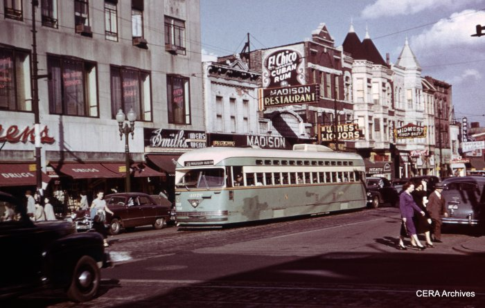 CTA Pullman PCC 4076 at Madison and Pulaski in 1949, showing patches of paint of a distinctly darker hue. At one time, this was one of the busiest shopping areas in the city. (James J. Buckley Photo - CERA Archives)