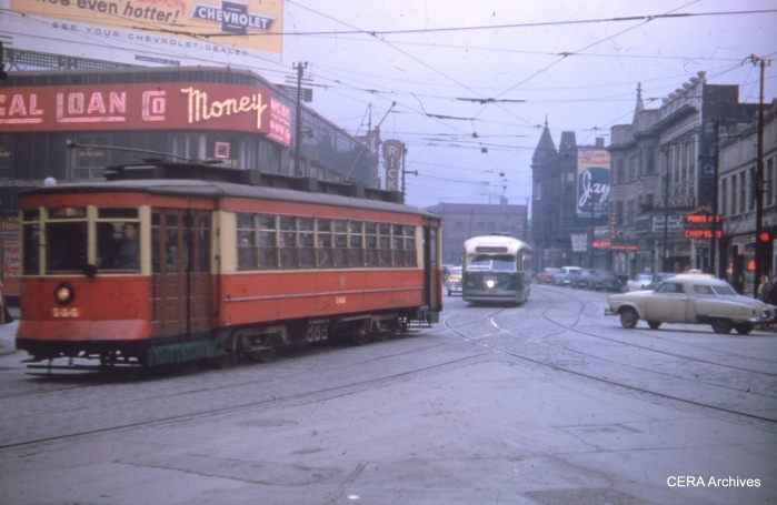 It's December 1956, and we are looking south at the intersection of Clark, Broadway, and Diversey. Car 225 (rebadged as 144) is on a fantrip, followed by a PCC that might be 7238. (CERA Archives)