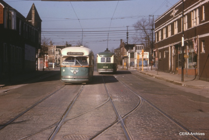CTA St. Louis-built PCC 7211 and Pullman-built 4116, in contrasting color schemes. We are at 81st and Halsted, facing west, and the time is most likely 1952. (CERA Archives