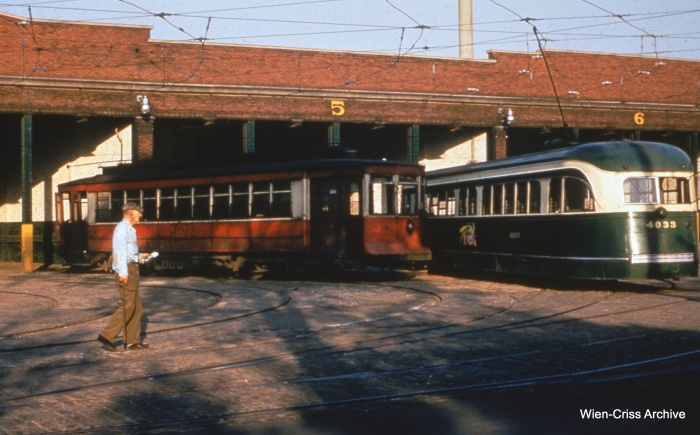 It's July 1954, a month after the end of CTA red car service. But car 597 is still on the scene here at 38th and Cottage Grove. Pre-war PCC 4033 is at right. (Bill Hoffman Photo - Wien-Criss Archive)