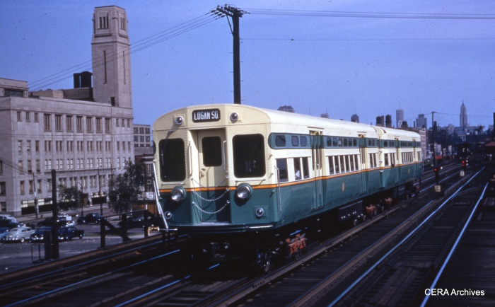 "CTA 6001-6002 at Marshfield on the Garfield Park ""L"" circA 1950. The first batch of 6000s, which had flat doors, were ordered for use in the Dearborn-Milwaukee subway, which opened in February 1951. At this location, trains branched off in three directions, to Logan Square/Humboldt Park, Garfield Park, and Douglas Park. (J. R. Williams Photo - CERA Archives)"