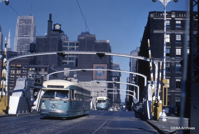 CTA Pullmans 4070 and 4104 westbound at Monroe and Canal on the #20 Madison route in April 1950. (CERA Archives)