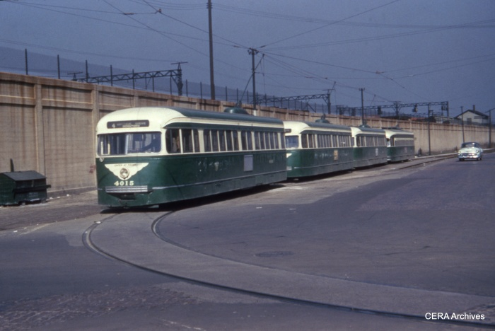It's March 24, 1954 at Cottage Grove and 115th. CTA PCC 4015 heads the lineup. (CERA Archives)