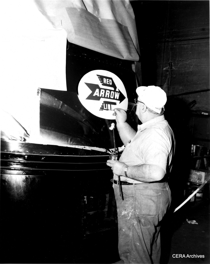 "The Red Arrow logo being applied to a newly christened ""Liberty Liner"" on January 4, 1964. (David H. Cope Photo - CERA Archives)"