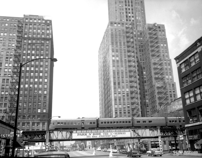 "Electroliner 801-802 on the Lake Street leg of Chicago's Loop ""L"", circa 1958, with a good view of Discount Records at right. From a 4x5 negative. (CERA Archives)"