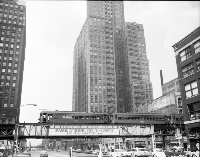 "North Shore combine 250 heads up this train on the Lake Street leg of the Loop ""L"". We are looking north on LaSalle Street, and the cars date the picture to about 1958. According to Don's Rail Photos, ""250 was built by Jewett in 1917. It had its seating reduced from 40 to 28 on July 28, 1925."""