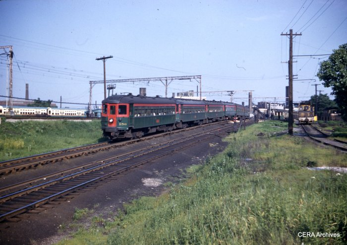 "CNS&M 156 leads up an outbound six car train just north of Howard, going into the Skokie Valley Route. This came from a ""superslide,"" shot on size 828 Kodachrome roll film, yielding an image slightly larger than 35mm. (W. H. Higginbotham Photo - CERA Archives)"