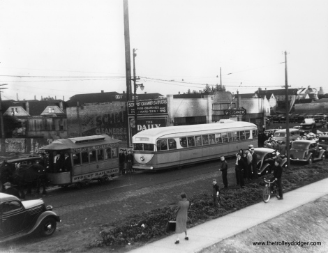 "It's August 28, 1936 on north Ashland Avenue, and time for a parade. One week earlier, streetcar service had been extended north of Cortland in one of the final extensions under CSL. Prior to this time, this portion of the route had run on Southport, two blocks to the east. North Chicago Street Railroad ""Bombay roof"" horsecar 8 is ahead of the experimental 1934 Brill pre-PCC car 7001. Ironically, the older car survives at the Illinois Railway Museum, while 7001 was scrapped in 1959. Check out the barber stripes on the 7001's trolley pole."